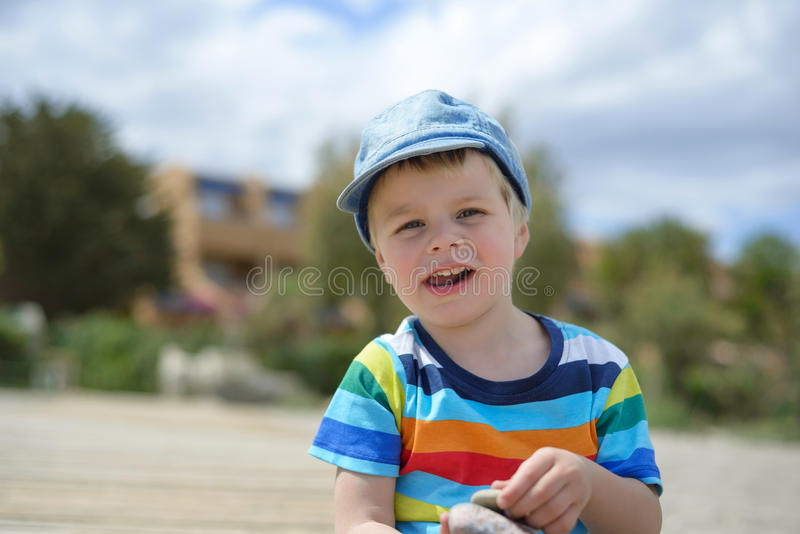 Happy little boy in multicolored t-shirt stock photography