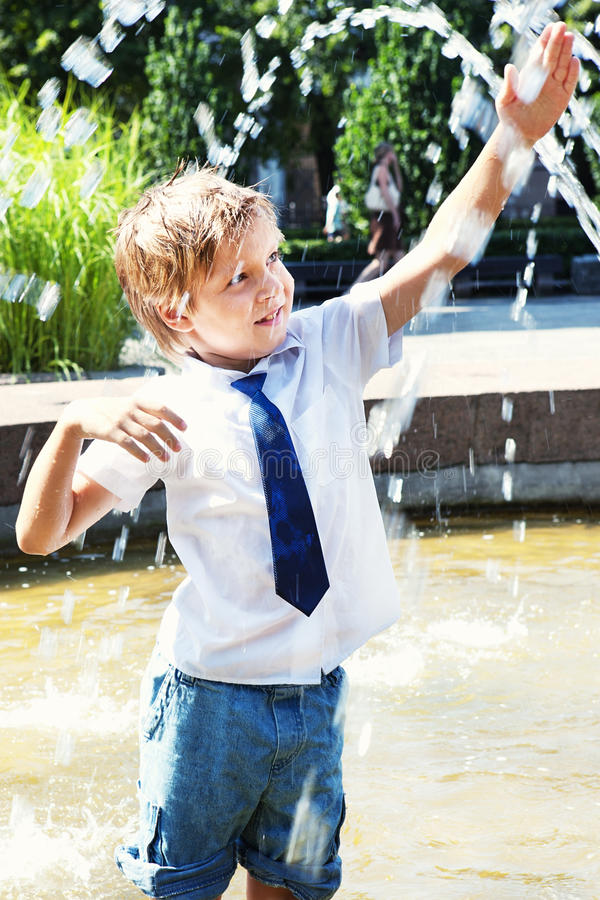 Download Happy Little Boy Play In The Fountain Stock Image - Image of play, park: 20579403