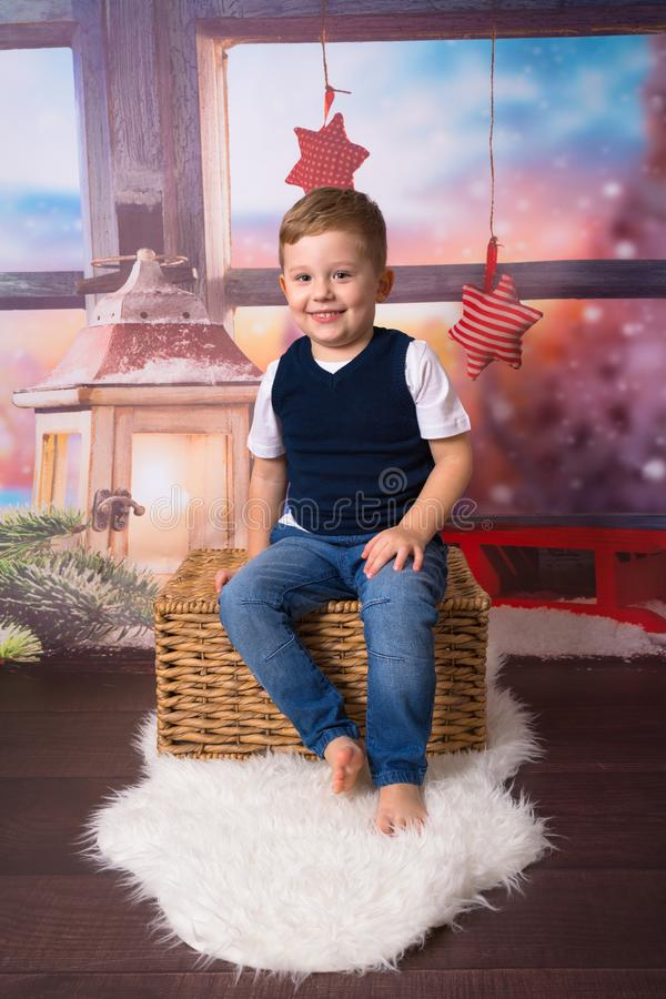 Happy little boy in christmas scenery royalty free stock photography