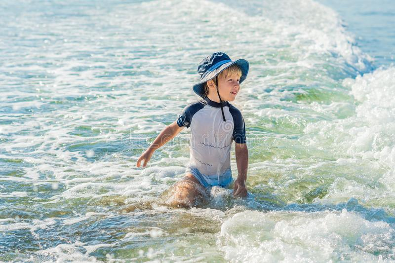 Happy little boy running on sand tropical beach royalty free stock photos