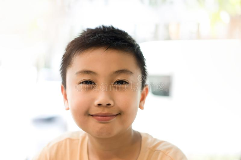 Happy little boy smiley face. Portrait human concept. Kid happy and freshness stock photo