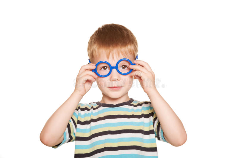 Happy little boy wearing glasses. royalty free stock images