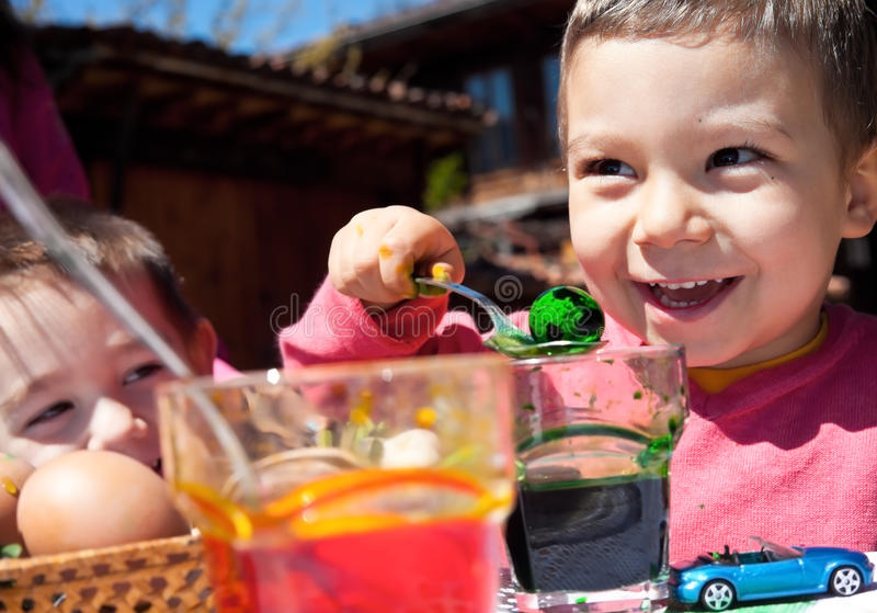 Download Happy Little Boys Dyeing Easter Eggs Stock Image - Image: 23539389