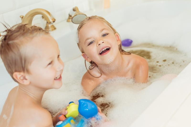 happy little brother and sister playing together stock photos