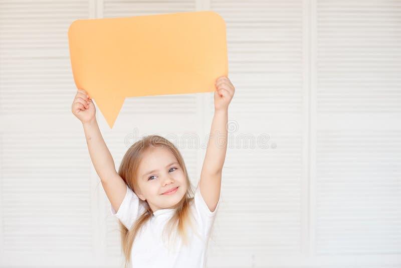 Happy Little Caucasian Girl Holding Blank Speech Bubble stock image