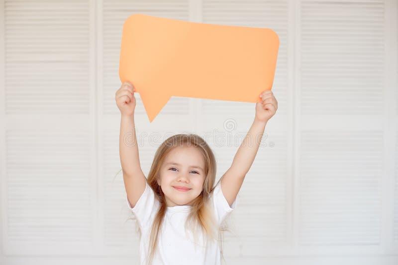 Happy Little Caucasian Girl Holding Blank Speech Bubble stock photography