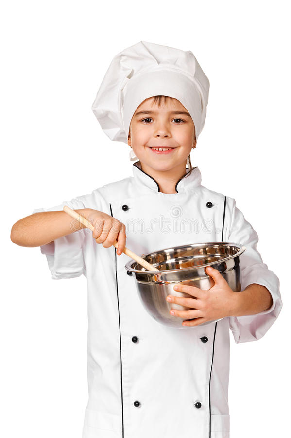 Happy little Chef girl with ladle girl having fun making cookies royalty free stock photography