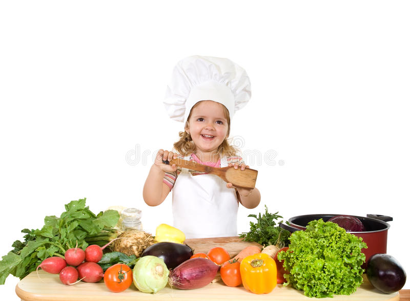Happy little chef with lots of vegetables stock images
