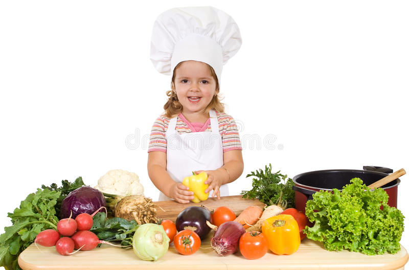 Happy little chef with vegetables. Preparing a healthy meal stock images