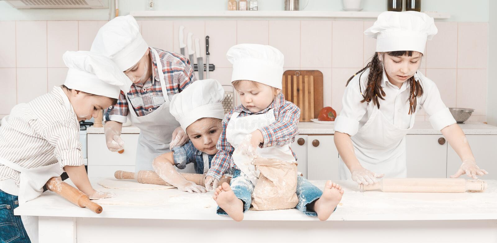 Download Happy Little Chefs Preparing Dough In The Kitchen Stock Photo - Image of child, cookies: 31085802