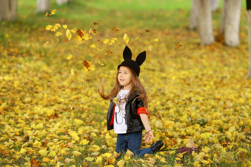 Happy little child, baby girl laughing and playing in the autumn on the nature walk outdoors. royalty free stock photos