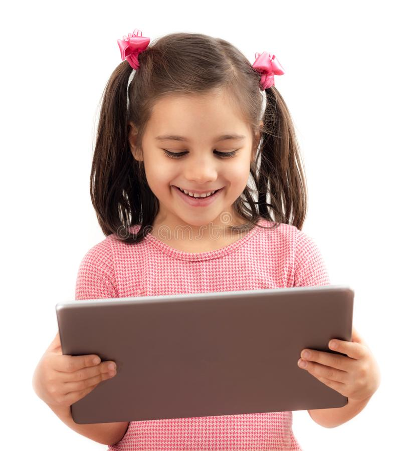 Happy Little Child Girl Using Digital Tablet, Isolated on White stock photo