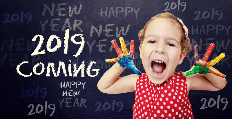 Happy little child with Santa hat. Happy child announcement New 2019 Year royalty free stock image