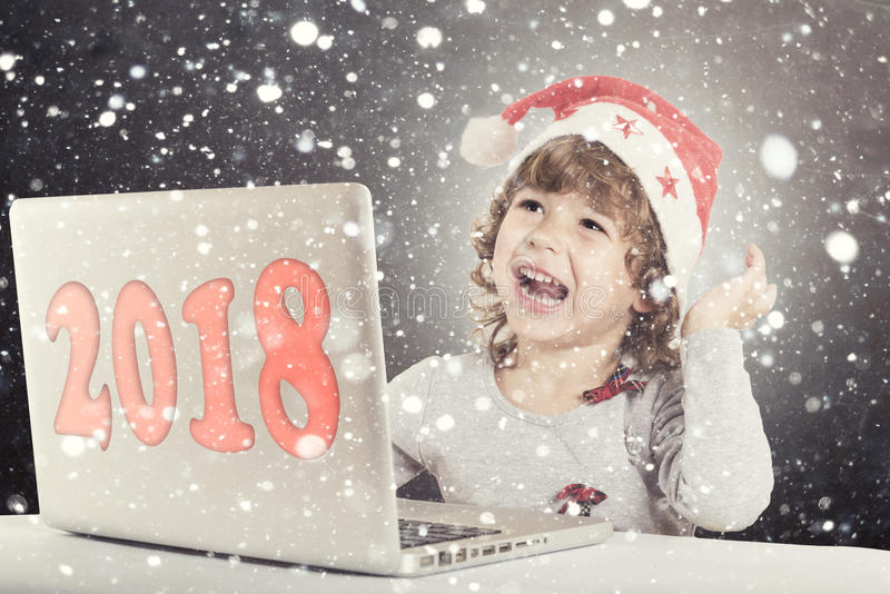 Happy little child. With Santa hat and laptop computer,selective focus royalty free stock images