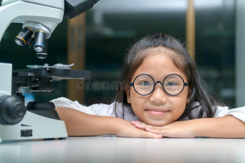 Happy Little child smile and learning in school laboratory stock photos