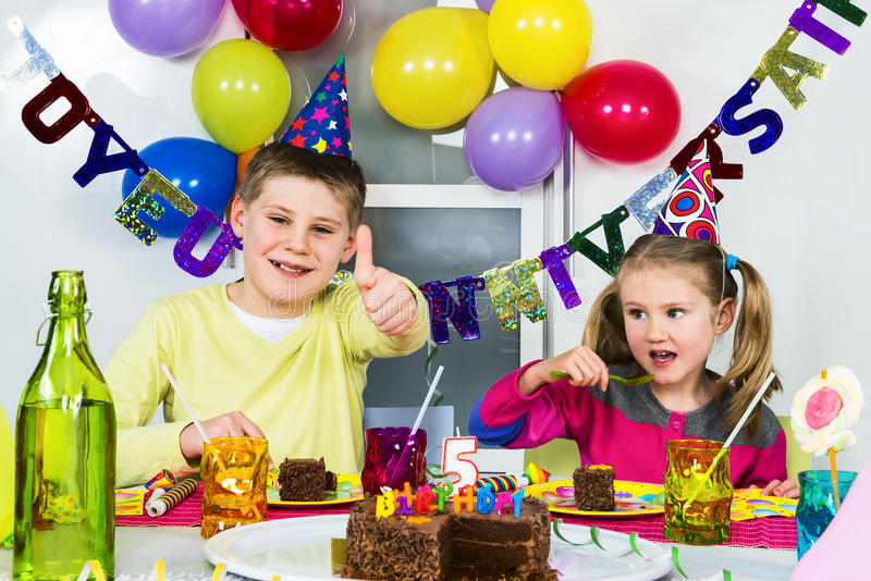 Big funny birthday party. Happy little children are having fun in a birthday party stock image