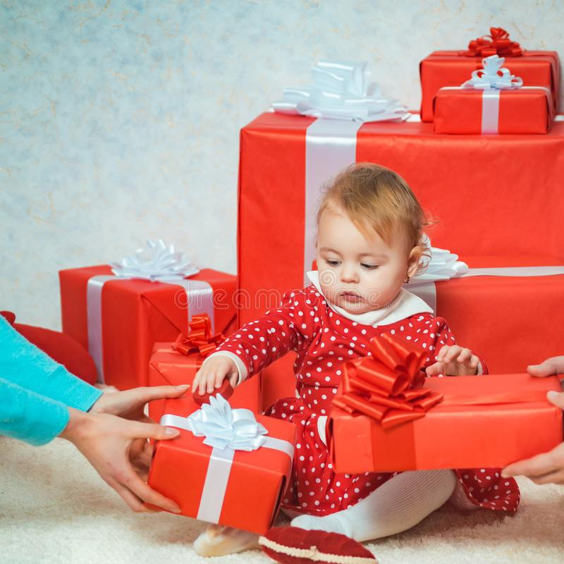 Happy little dreamy girl with christmas gift box. Happy holiday. Happy christmas. Family winter holidays and people. Concept. Christmas eve. Shopping sale stock photos