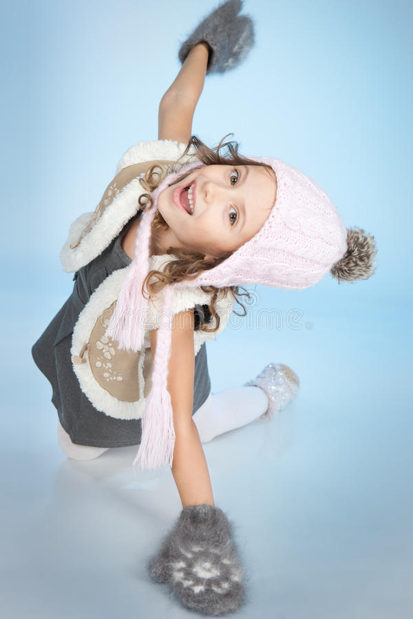 Happy little gir havingl fun at winter time stock images