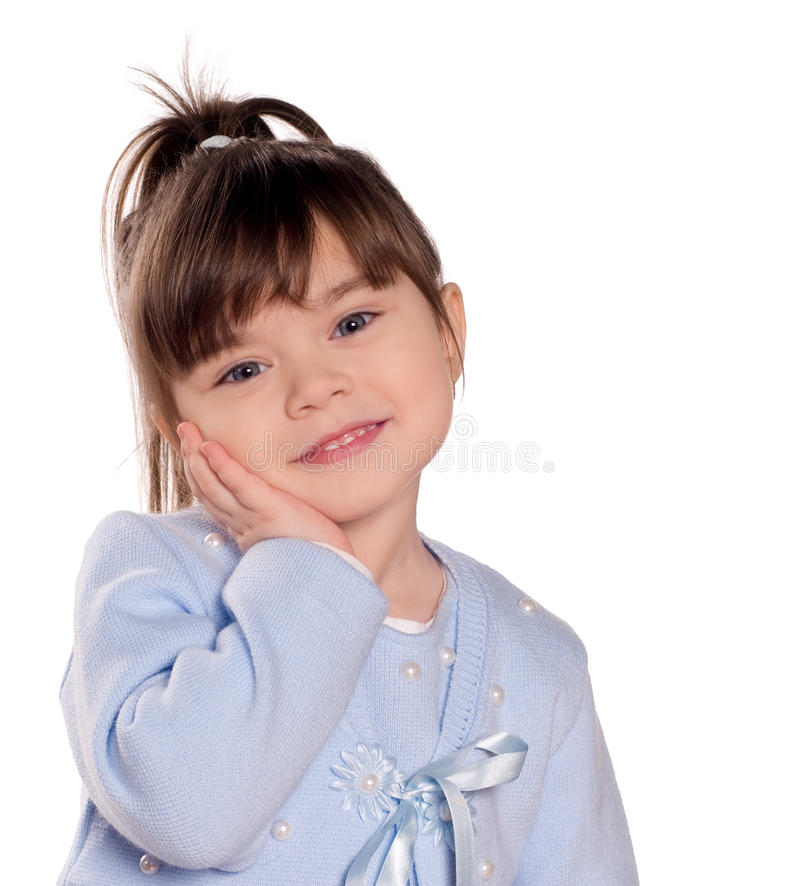 Happy little girl. Funny child isolated on white background. Beautiful caucasian model royalty free stock photos