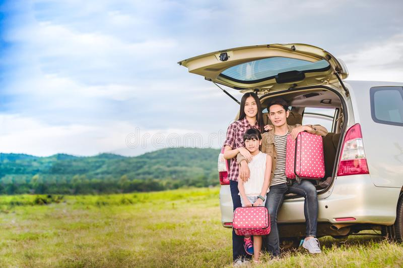 Happy little girl with asian family sitting in the car for enjo. Ying road trip and summer vacation in camper van stock images