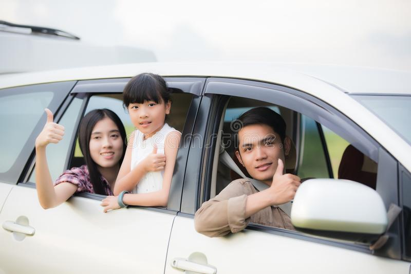 Happy little girl with asian family sitting in the car for enjo. Ying road trip and summer vacation in camper van stock photos