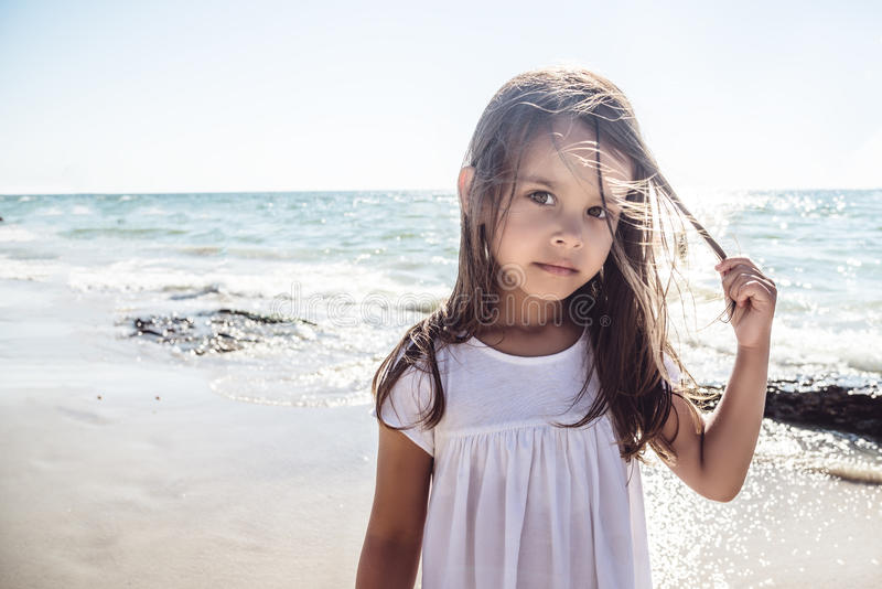 Happy little girl on the beach royalty free stock photography