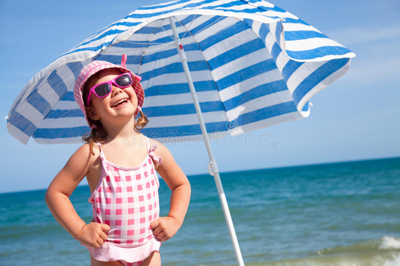 Happy little girl on beach stock photography