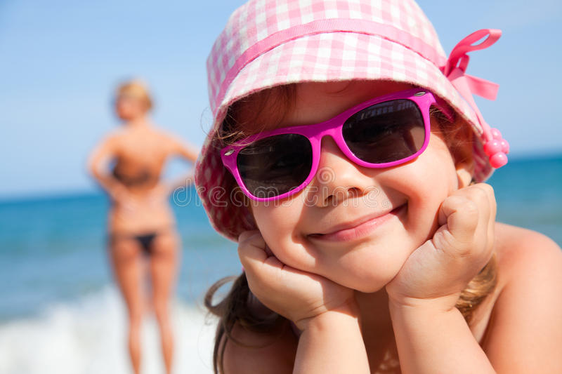 Happy little girl on beach stock images