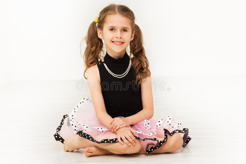Happy little girl in beautiful dress and necklace royalty free stock photo