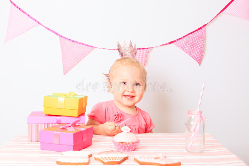 Happy little girl at birthday party. Happy little girl with presents at birthday party stock photography