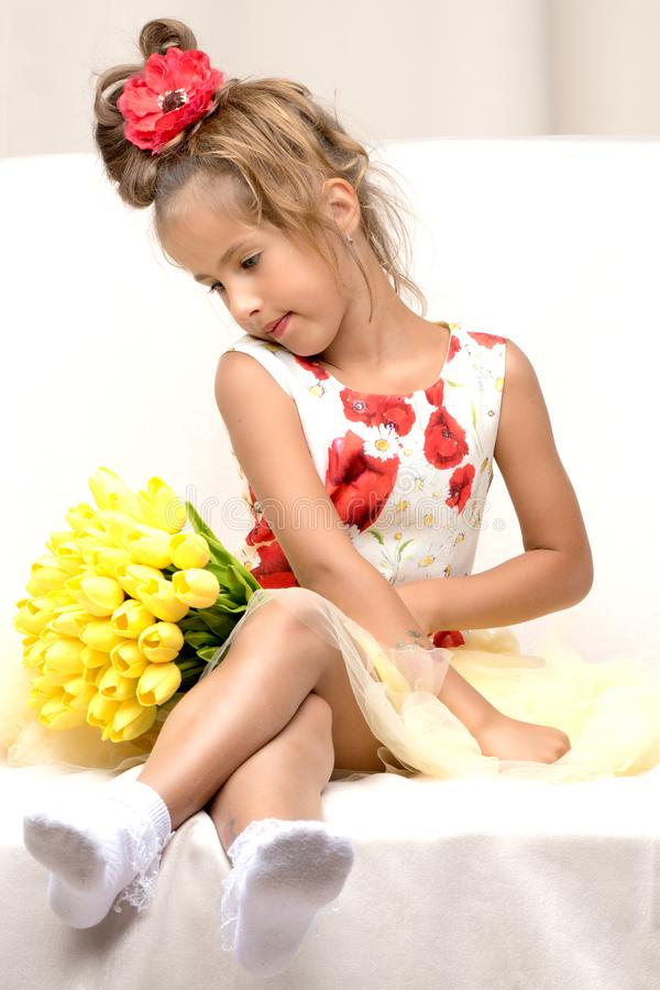 Little girl with a bouquet of flowers royalty free stock photo