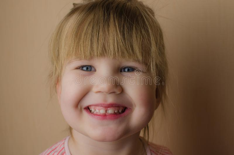 Happy little European girl brushing her teeth stock image