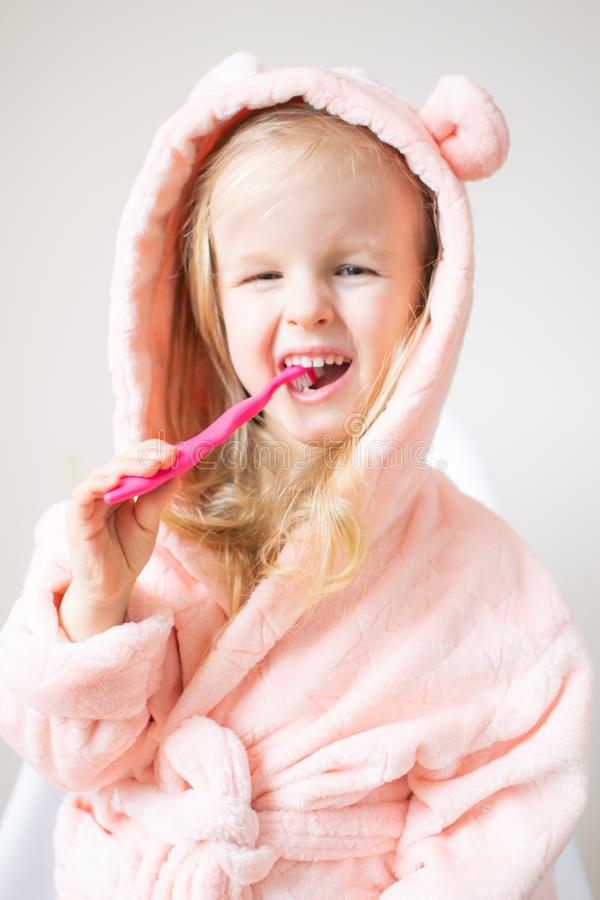 Happy Little Girl Brushing Her Teeth, Pink Toothbrush, Dental Hygiene, Morning Night Healthy stock photos