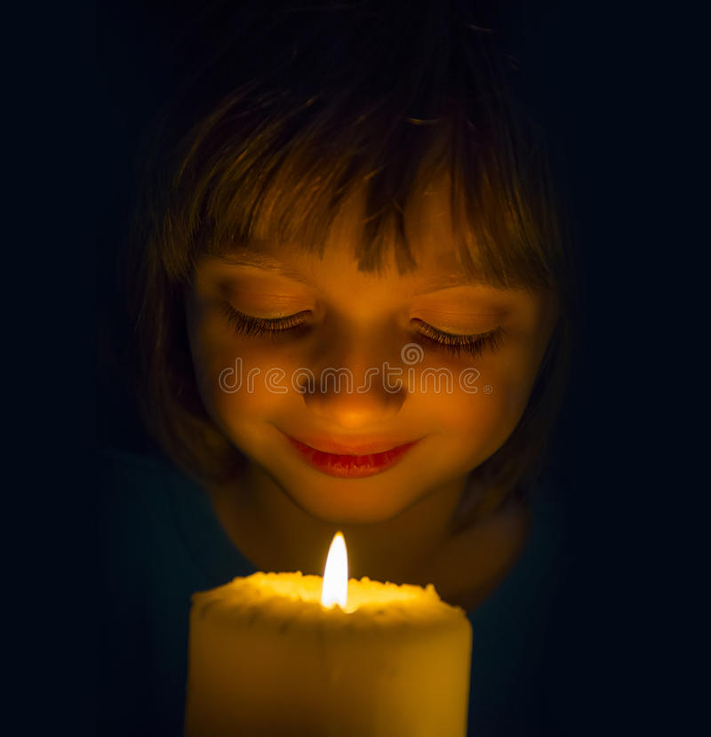Happy little girl with a candle. Happy girl with a candle royalty free stock photography