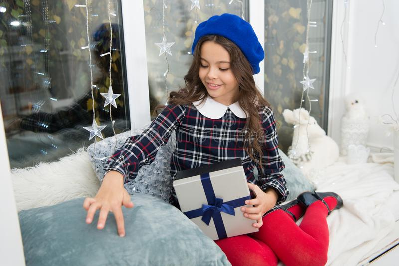 Happy little girl celebrate winter holiday. happy new year. christmas time. Cute little child girl with xmas present stock photo