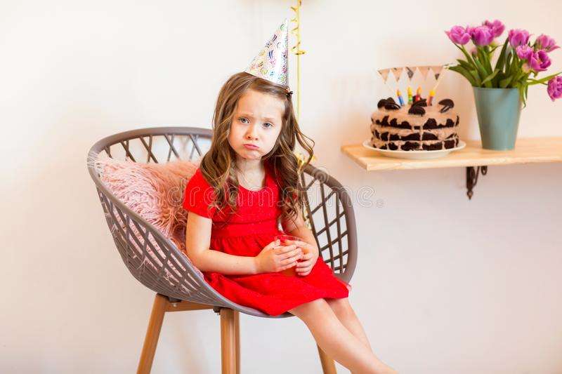 Happy little girl celebrating the fourth birthday at home stock photos