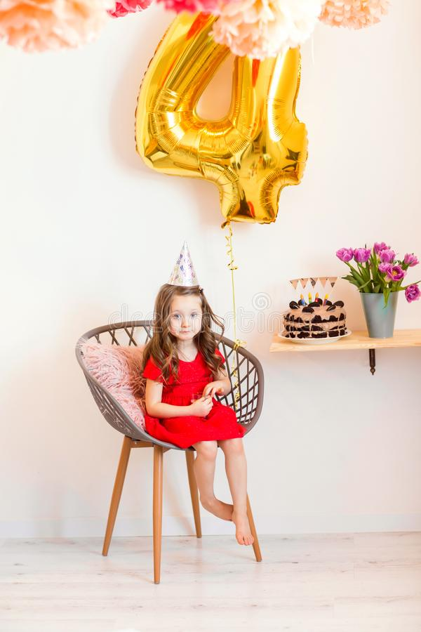 Happy little girl celebrating the fourth birthday at home royalty free stock photos