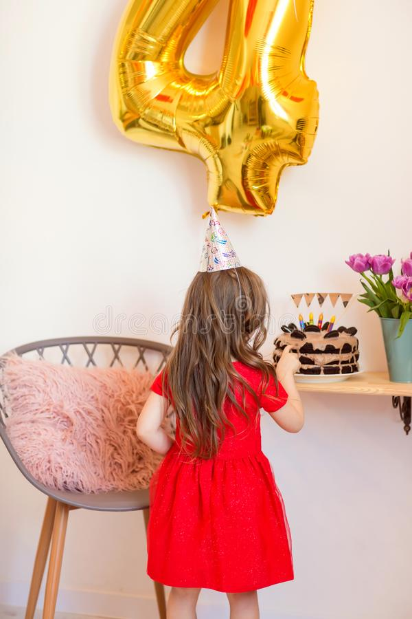 Happy little girl celebrating the fourth birthday at home stock images