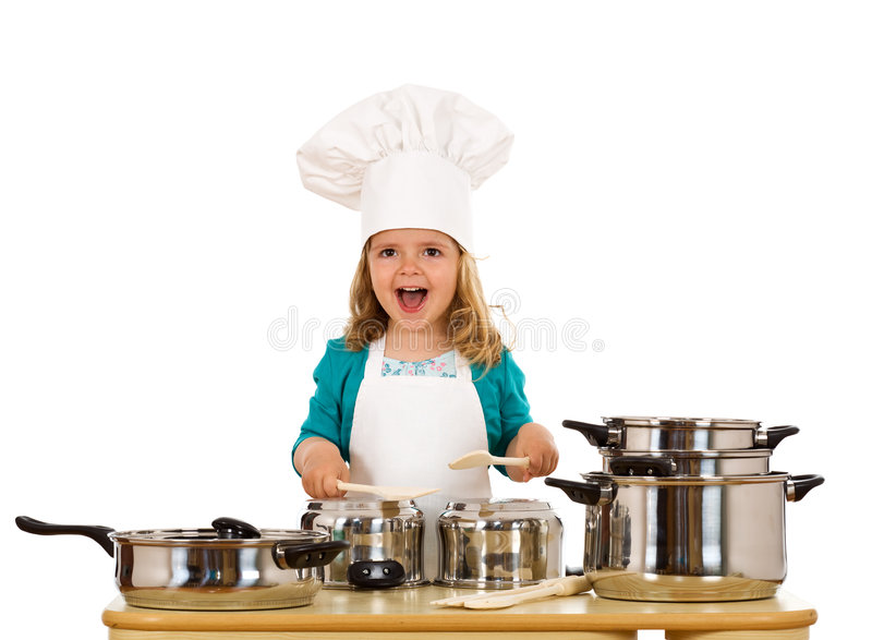 Happy little girl with chef hat making noise royalty free stock photo