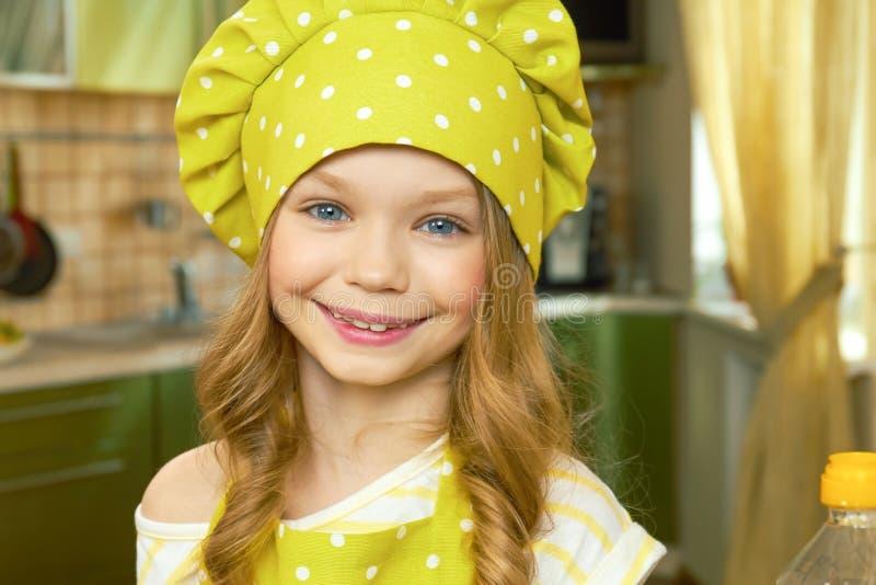 Happy little girl, chef uniform. royalty free stock photo