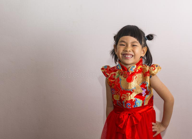 Happy little girl in Chinese New Year costume stock photography