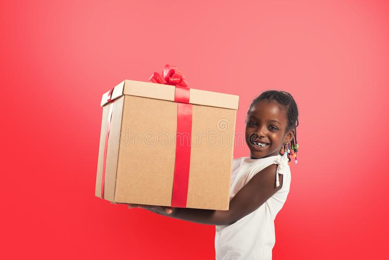 Happy little girl with a Christmas gift. royalty free stock photo