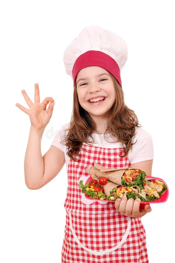 Little girl cook with burritos mexican food. Happy little girl cook with burritos mexican food stock photos