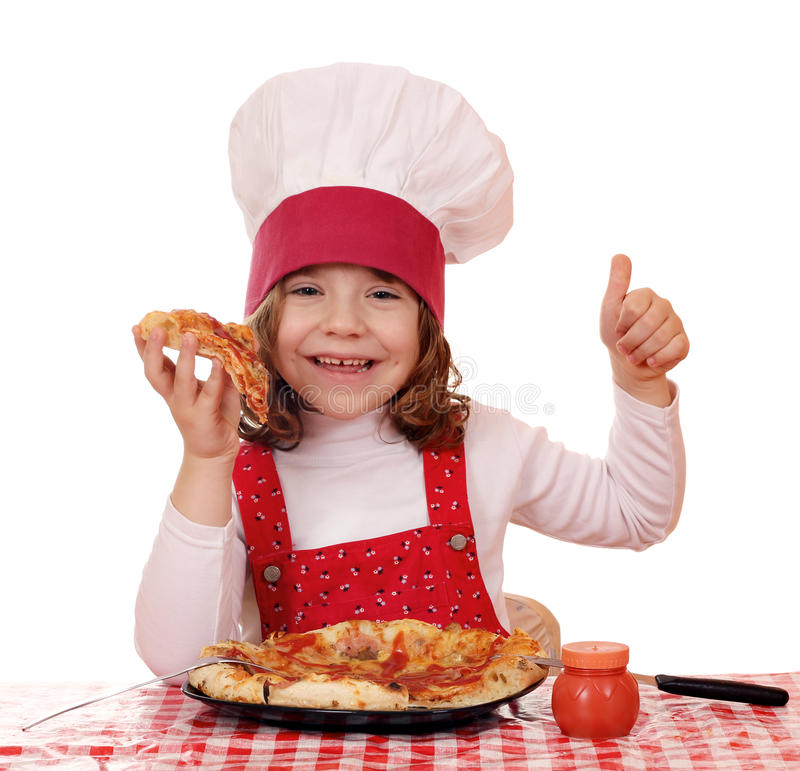 Little girl cook eat pizza. Happy little girl cook eat pizza stock photos