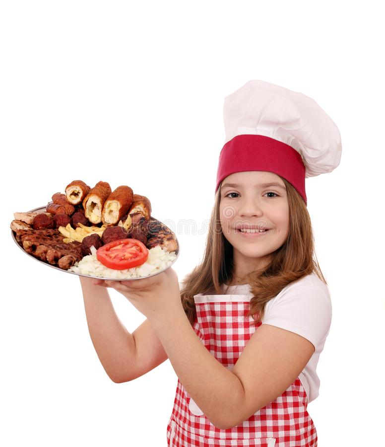 Little girl cook with mixed grilled meat royalty free stock images