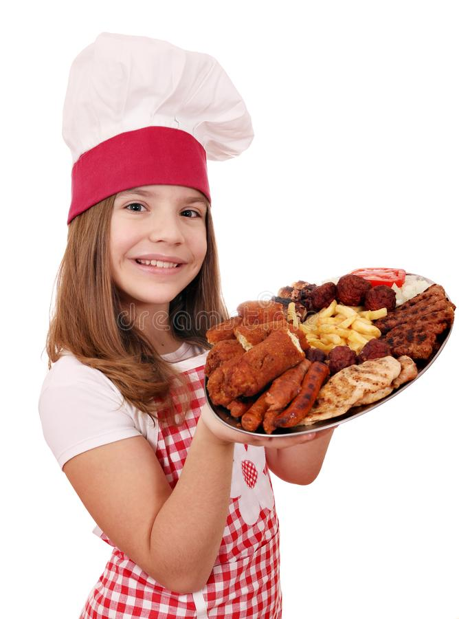 Little girl cook with mixed grilled meat on plate royalty free stock image