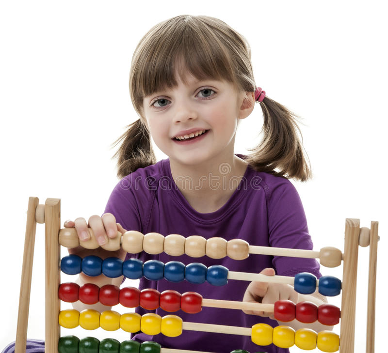 Happy little girl counting with abacus royalty free stock images