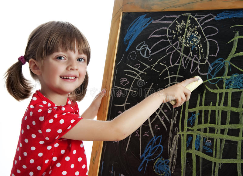 Happy little girl drawing picture royalty free stock images