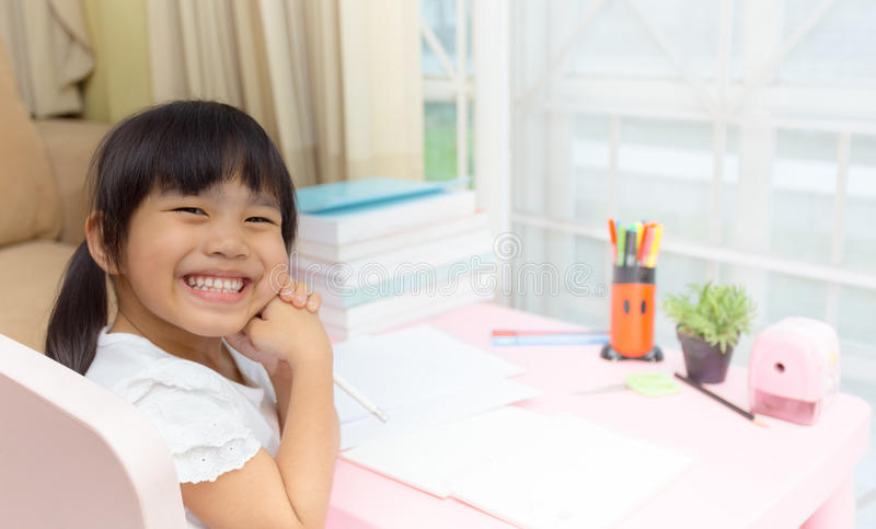 Happy little girl and early education. little kids doing his homework for fun and learning.  royalty free stock images
