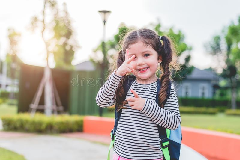 Happy little girl enjoy going to school. Back to school and Education concept. Happy life and family lifestyle theme stock image